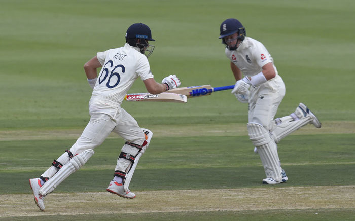 England's Joe Root (L) and England's Ollie Pope (R) runs between the wickets during the first day of the fourth Test cricket match between South Africa and England at the Wanderers Stadium in Johannesburg on 24 January 2020. Picture: AFP