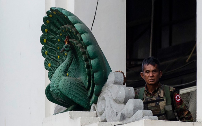A soldier stands guard in City Hall in Yangon on 1 February 2021, after Myanmar's military seized power in a bloodless coup on Monday, detaining democratically elected leader Aung San Suu Kyi as it imposed a one-year state of emergency. Picture: AFP