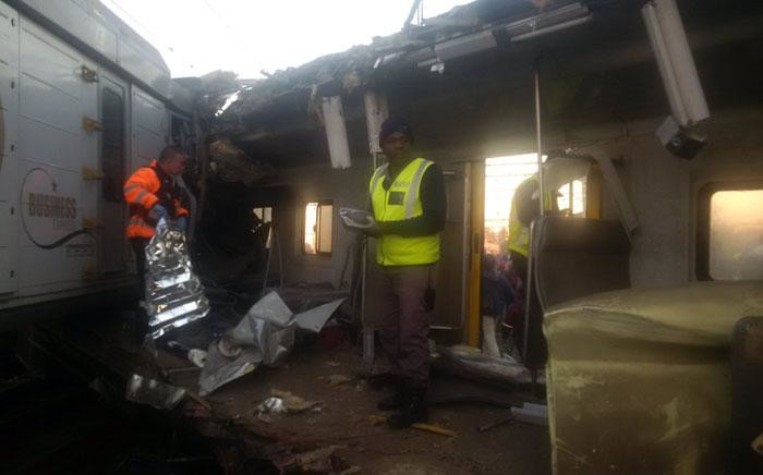 Authorities inspect the inside of a Metrorail train after a train crash in Elandsfontein. Picture: Twitter/@EWNTraffic