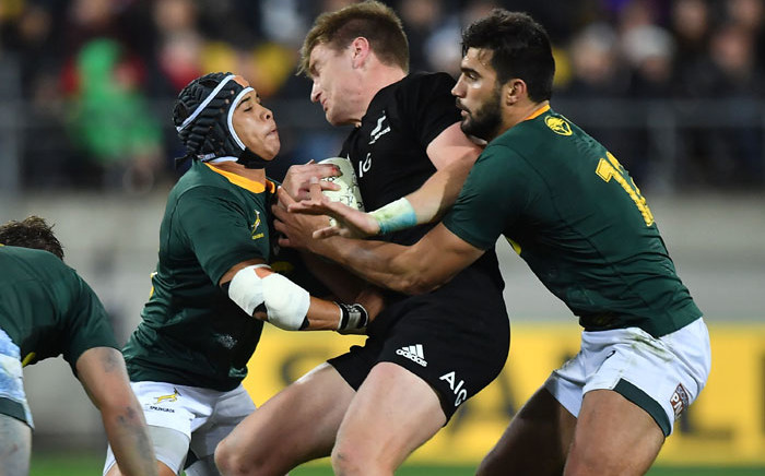 New Zealand's Jordie Barrett (C) is tackled by South Africa's Cheslin Kolbe and Damian de Allende (R) during their Rugby Championship match at the Westpac Stadium in Wellington on 15 September, 2018. Picture: AFP