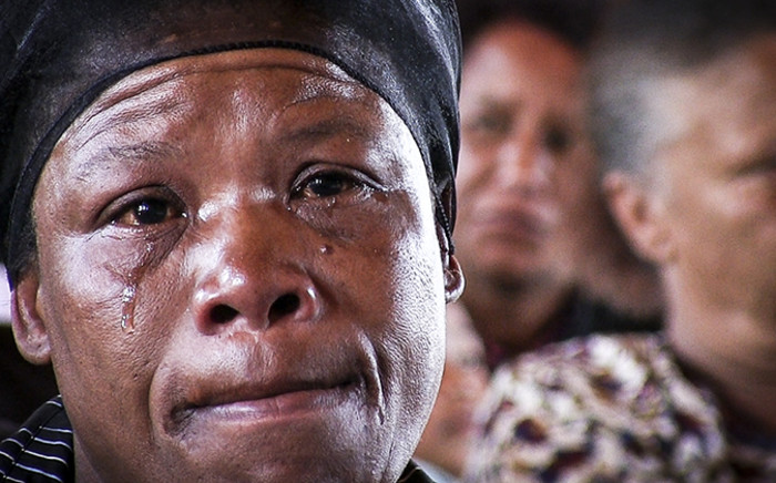 One of Justin Langley's relatives cries at his and his uncle Barend Langley's funeral in Uitsig, Cape Town. Picture: Thomas Holder/EWN