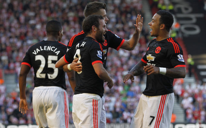 Memphis Depay and Morgan Schneiderlin congratulate Juan Mata on scoring Man United's third goal against Southampton on 20 September 2015. Picture: AFP