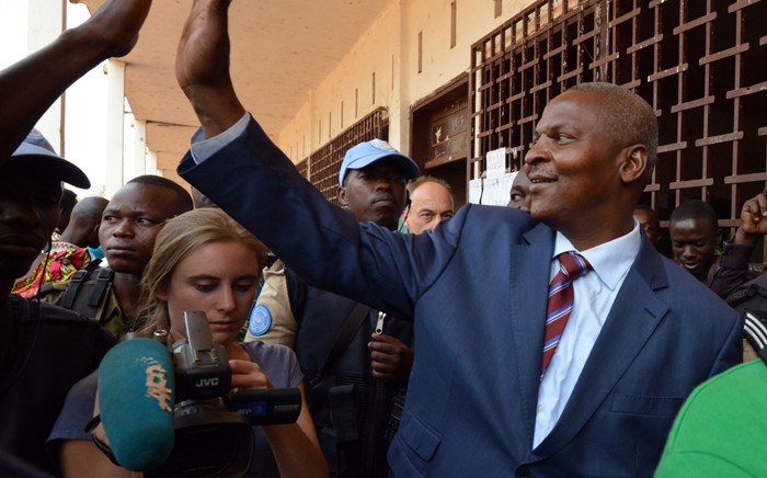 This file photo taken on 14 February, 2016 shows Central African Republic second round presidential candidate Faustin Archange Touadera greeting a supporter as he leaves after voting for delayed legislative elections and a presidential run-off, at a polling station in Bangui. Picture: AFP.