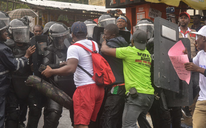 Police deployed as the organisers of the June 7 protest take to the streets in the capital Monrovia on 31 July 2019. Picture: AFP