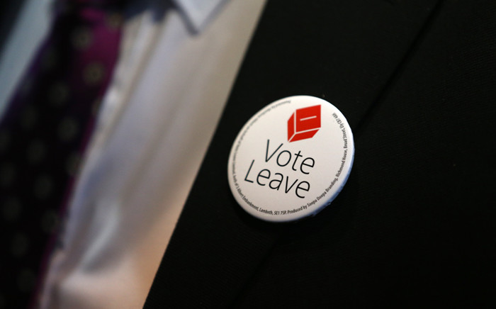 file: Campaign memorabilia is pictured on the jacket of a man as he attends the world premiere of the film 'Brexit: the Movie' in London's Leicester Square. Picture: AFP.