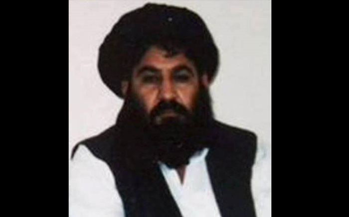 This handout file photo released by the Afghan Taliban on 3 December 2015, which was taken on a mobile phone in mid-2014 is said to show Afghan Taliban leader Mullah Akhtar Mansour posing for a photograph at an undisclosed location in Afghanistan. Picture: Handout/Afghan Taliban/AFP