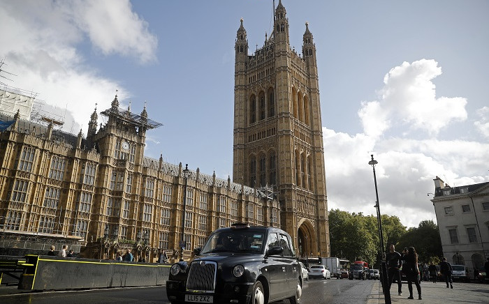 FILE: A black London taxi cab is drivens past the Houses of Parliament in central London on September 24, 2019 after the judgement of the court on the legality of Boris Johnson's advice to the Queen to suspend parliament for more than a month, as the clock ticks down to Britain's October 31 EU exit date. Picture: AFP
