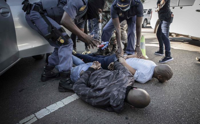 Two men are arrested for possession and transporting two bags of dagga and boxes of cigarettes. Picture: Abigail Javier/EWN