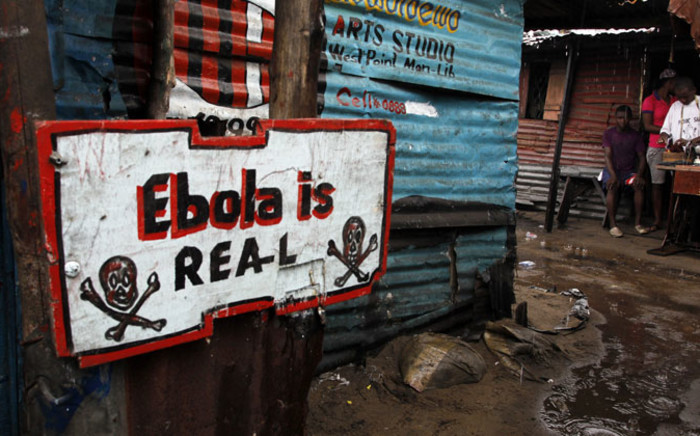 FILE: An Ebola sign placed in front of a home in the West Point slum area of Monrovia, Liberia. Picture: EPA.