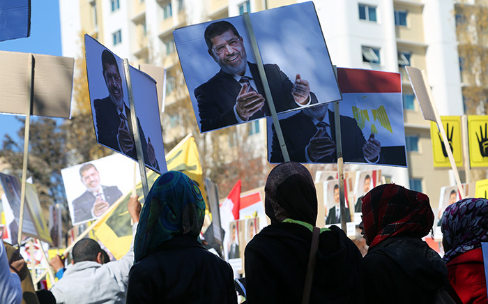Several civil society groups from countries including Egypt, Lesotho and Zimbabwe demonstrated outside the Sandton Convention Centre on 14 June to express their grievances with issues they believe the African Union summit is not dealing with. Picture: Reinart Toerien/EWN.