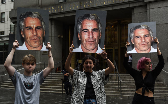 In this file photo taken on 8 July 2019, A protest group called 'Hot Mess' hold up signs of Jeffrey Epstein in front of the Federal courthouse in New York City. Picture: AFP