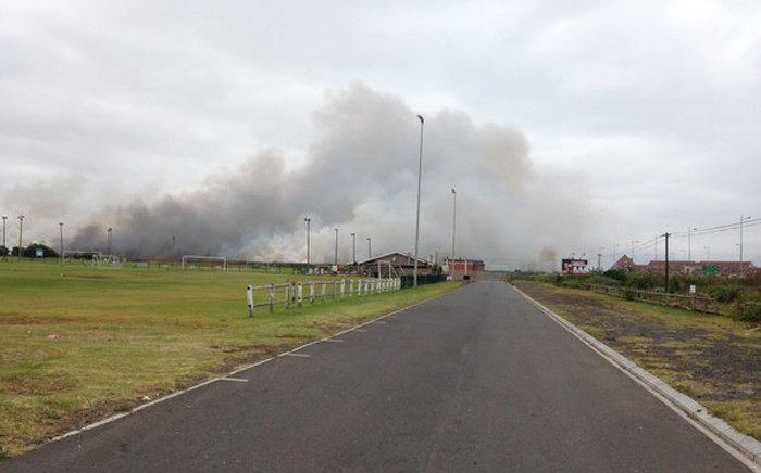 Firefighters have been working since midnight to douse a blaze in the Table View area on 6 November 2015. Picture: Lauren Isaacs/EWN.