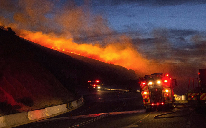 Firefighters are monitoring the area for flare-ups. Picture: Eric de Korte/iWitness.