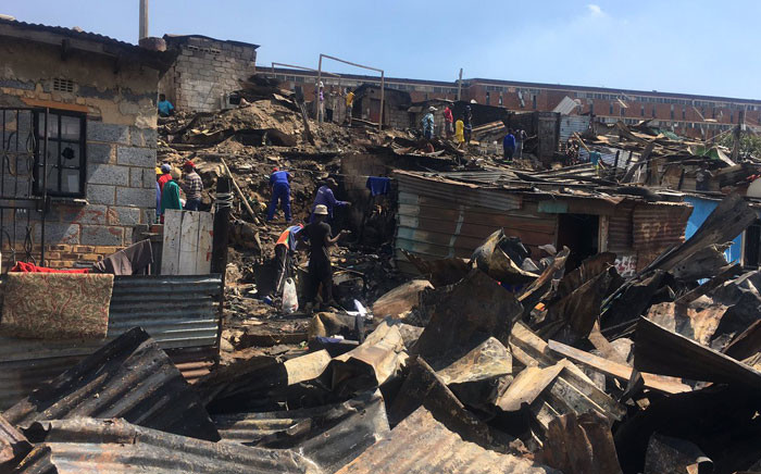 More than 60 homes were burned in a fire in the Alexandra township on Tuesday, 4 April 2017. Picture: Katleho Sekhotho/EWN.