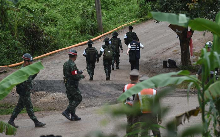 FILE: Thai military paramedics head to Tham Luang cave area as divers began evacuation of the 12 boys and their coach trapped at the cave in Khun Nam Nang Non Forest Park. Picture: AFP.
