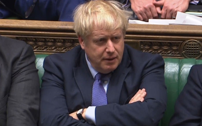 A video grab from footage broadcast by the UK Parliament's Parliamentary Recording Unit (PRU) shows Britain's Prime Minister Boris Johnson reacting during the debate on the Brexit withdrawal agreement bill in the House of Commons in London on 22 October 2019. Picture: AFP