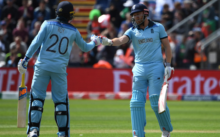 England's Jason Roy (L) and teammate England's Jonny Bairstow touch gloves after reaching their 50 partnership during the 2019 Cricket World Cup group stage match between England and Bangladesh at Sophia Gardens stadium in Cardiff, south Wales, on 8 June 2019. Picture: AFP