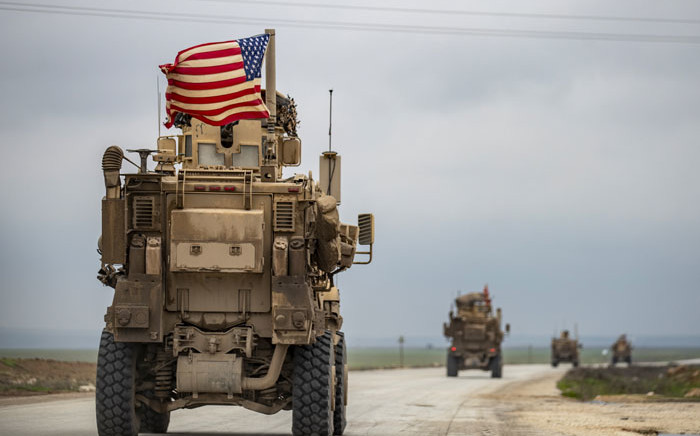 A US military convoy drives on the outskirts of the Kurdish-controlled northern Syrian city of Qamishli on 9 January 2020. Picture: AFP