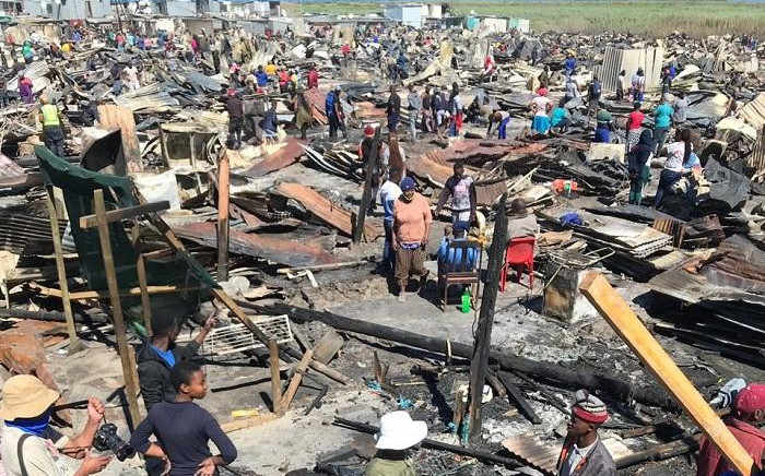 Masiphumelele residents sifting through debris following a blaze that destroyed around 1,000 homes on 17 December 2020. Picture: Kevin Brandt/EWN