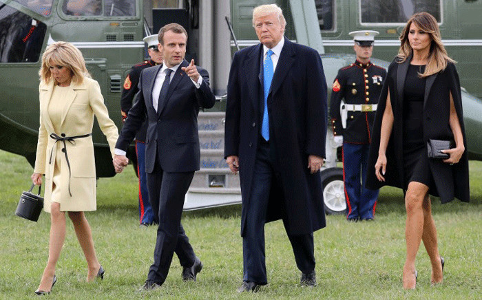 French first lady Brigitte Macron and French President Emmanuel Macron walk with US President Donald Trump and US first lady Melania Trump upon arrival at Mount Vernon, the estate of the first US President George Washington, in Mount Vernon, Virginia, 23 April, 2018. Picture: AFP.
