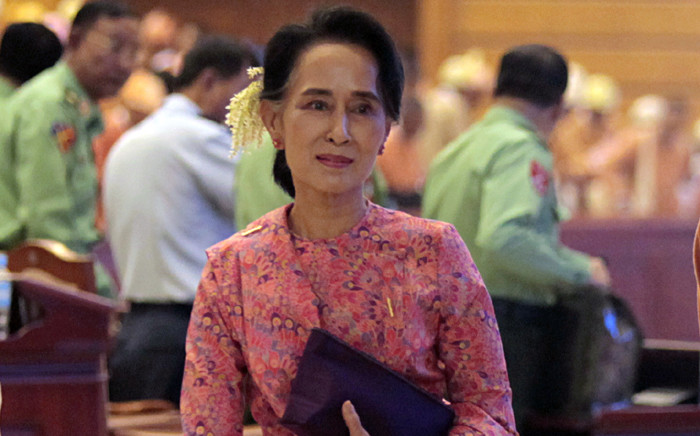 Myanmar democracy leader Aung San Suu Kyi leaves after attending the first day of a new parliament session in Naypyitaw, Myanmar, on 1 February 2016. Picture: EPA/Hein Htet.