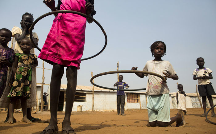 Gonzalez Farran/AFPChildren play with hula hoops at the Children Friendly Space, run by Unicef. According to Unicef, South Sudan has the highest proportion of out of school children in the world. Picture: Albert Gonzalez Farran/AFP.