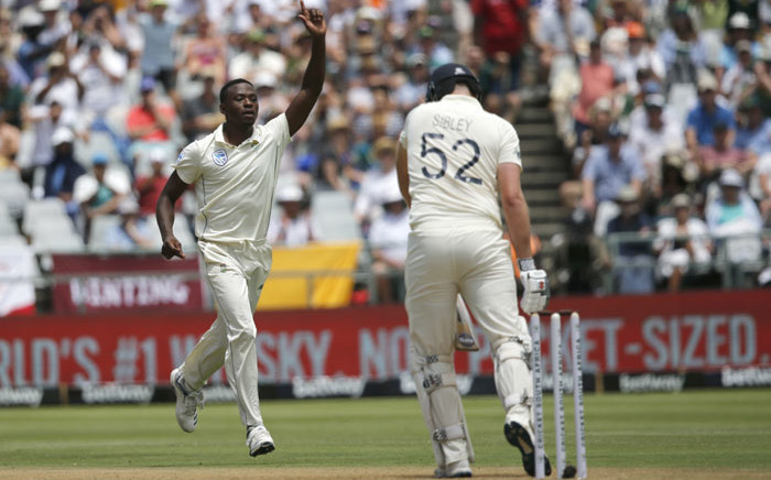 South Africa's Kagiso Rabada (L) celebrates after the dismissal of England's Joe Denly (R) during the first day of the second Test cricket match between South Africa and England at the Newlands stadium in Cape Town on 3 January 2020. Picture: AFP