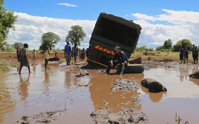 Rescue SA team members battle to free a truck used to deliver food aid to flood victims from the mud on 24 January 2015. Picture: Aletta Gardner/EWN