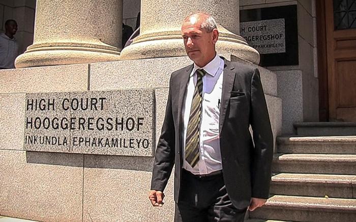Captain Paul Hendrikse leaves the Western Cape High Court on 11 November 2014. Picture: Sibulele Roji/EWN.