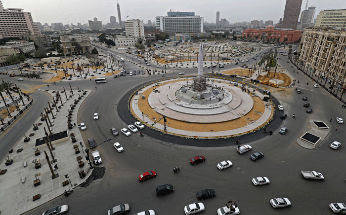 FILE: Cars drive in the Egyptian capital Cairo's Tahrir square, shortly before the first day of a two-weeks night-time curfew imposed by the authorities to contain the spread of the novel coronavirus began on 25 March 2020. Picture: AFP