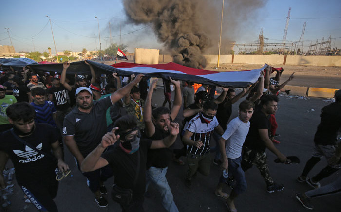 Iraqi protesters take part in a demonstration against state corruption, failing public services, and unemployment, in the Iraqi capital Baghdad's central Khellani Square on 4 October 2019. Picture: AFP