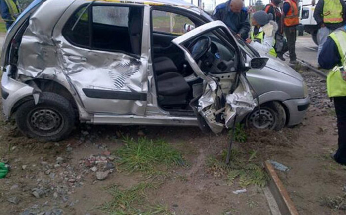 A family of four narrowly escaped death when a train hit their car at the Eerste River level crossing on 20 June 2013. Picture: Morne Esben/EWN