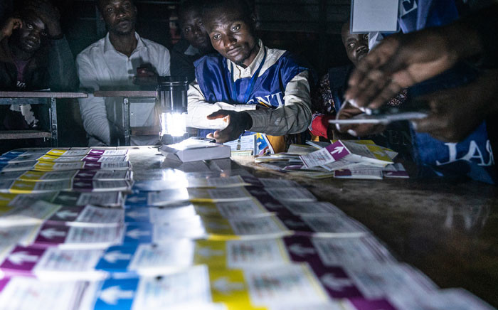 Independent National Electoral Commission (CENI) agents count votes during an electricity cut while watched by observers at Kiwele college in Lubumbashi on 30 December 2018, following the close of polls in the country's presidential, provincial and national elections. Picture: AFP