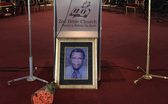 A picture of Khabisi Mosunkutu is seen at Zoe Bible Church in Pimville, Soweto, ahead of his memorial service on 29 December 2018. Picture: @GautengANC/Twitter.