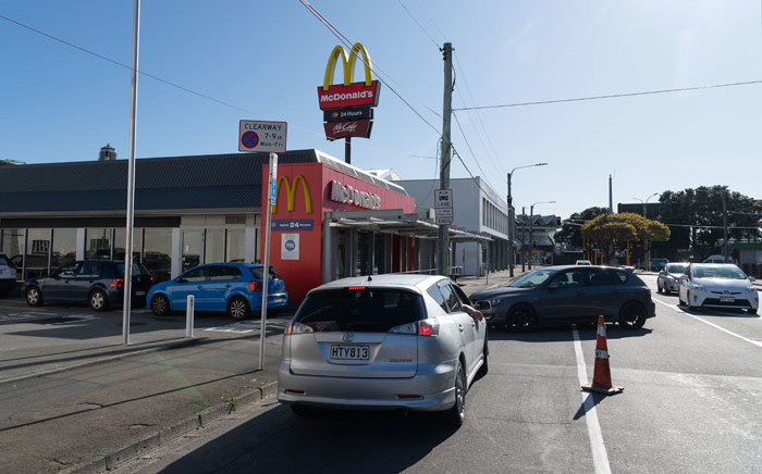 Customers queue up for the drive-thru at a McDonald's restaurant on the first day of the easing of lockdown restrictions in Wellington, New Zealand on 18 April 2020, following the coronavirus outbreak. Picture: AFP
