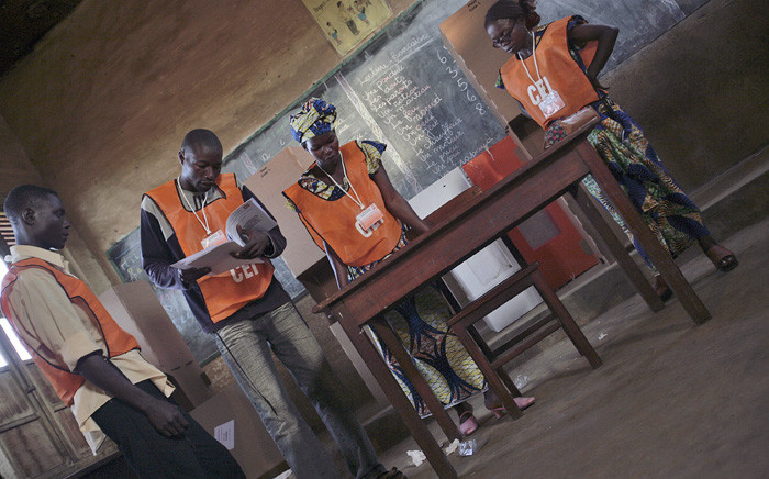 FILE: Election officers scrutinise voter registers in Bunia, Ituri, the Democratic Republic of the Congo. Picture: United Nations Photo.