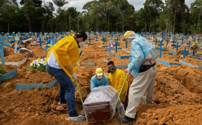 A burial takes place in an area reserved for COVID-19 victims at the Nossa Senhora Aparecida cemetery in Manaus, Brazil, on 5 January 2021. Picture: AFP.
