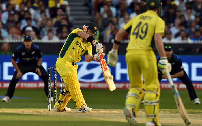 Australia's batsman David Warner (L) plays a shot during the 2015 Cricket World Cup final between Australia and New Zealand in Melbourne on March 29, 2015.  Picture: AFP