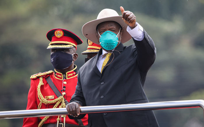 Ugandan President Yoweri Museveni (C) gestures while standing on a car during the inauguration ceremony for his sixth term at Kololo Ceremonial Grounds in Kampala, Uganda, on 12 May 2021. Picture: Badru Katumba/AFP