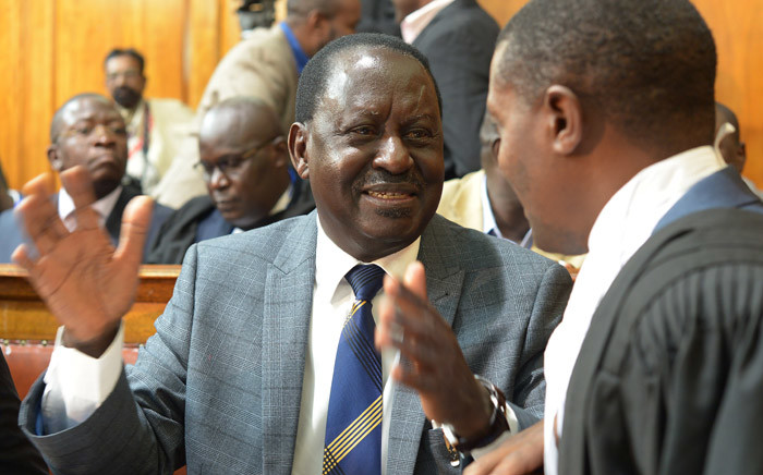 Kenya's opposition presidential candidate Raila Odinga (centre) reacts on 1 September 2017 after the Supreme Court in Nairobi nullified President Uhuru Kenyatta's election win in August. Picture: AFP