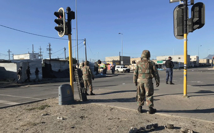 Soldiers join police and law enforcement officials in trying to bring stability in Dunoon amid protests. Picture: Kevin Brandt/EWN.