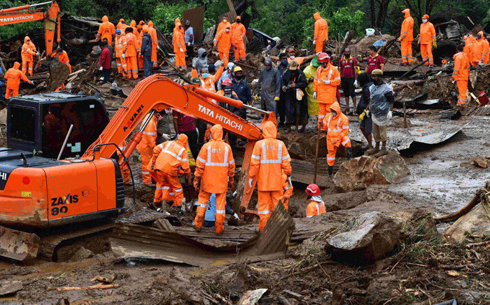 Rescue workers search for missing people at a landslide site caused by heavy rains in Pettimudy, in Kerala state, on 8 August 2020. Picture: AFP