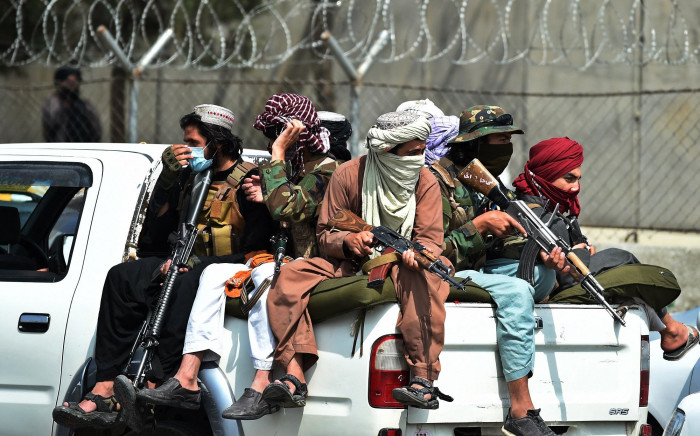 Taliban fighters guard outside the airport in Kabul on 31 August 2021. Picture: AFP