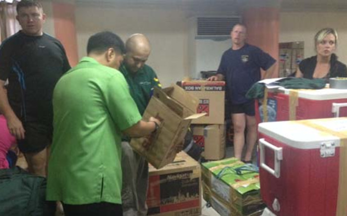 Gift of the Givers loading aid for victims of Typhoon Haiyan in Manila, Philippines. Picture: Govan Whittles/EWN.