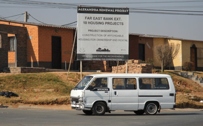FILE: A taxi drives past a housing development under the Alexandra Renewal Project. Picture: EWN