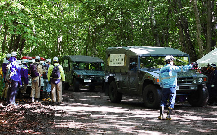 Self-Defence Forces vehicles head to search for a missing boy in Nanae on Japan's main northern island of Hokkaido, on 1 June 2016. Picture: AFP