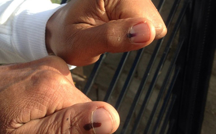 FILE: Voters show off their thumbs after voting. Picture: Shamiela Fisher/EWN.