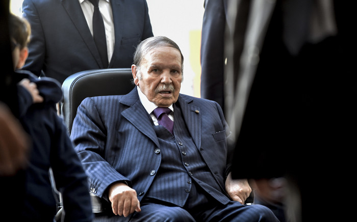 In this file photo taken on November 23, 2017, Algerian President Abdelaziz Bouteflika is seen while voting at a polling station in the capital Algiers during polls for local elections. Picture: AFP.