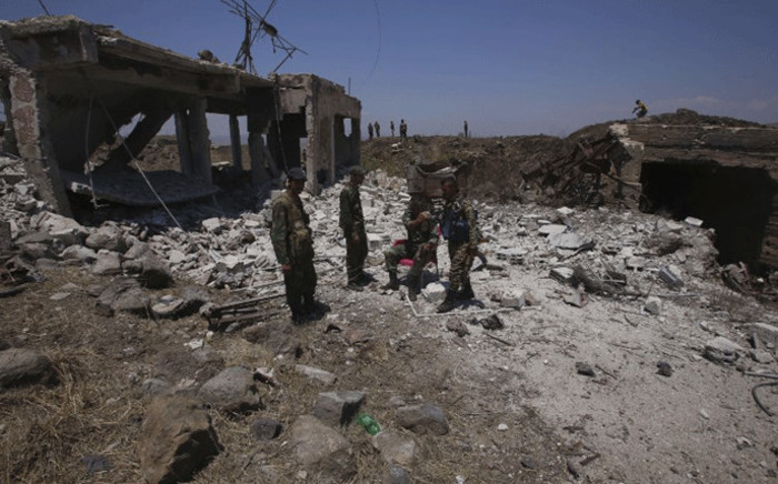 A picture taken on 22 July, 2018, during a government guided tour, shows Syrian regime forces gathering on al-Jabieh hill, during their advance on the town of Nawa, in the southern province of Daraa. Picture: AFP.