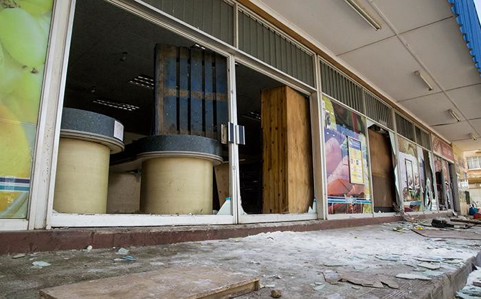 A number of shops that were looted and vandalised during protests in Coligny in the North West on 25 April 2017 following the death of a young boy. Picture: Reinart Toerien/EWN